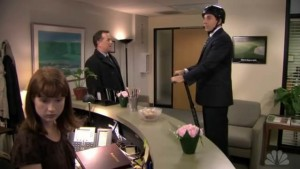 Michael rides a Segway to greet the office visitor.