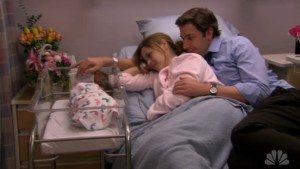 Pam and Jim look on at their newborn baby.
